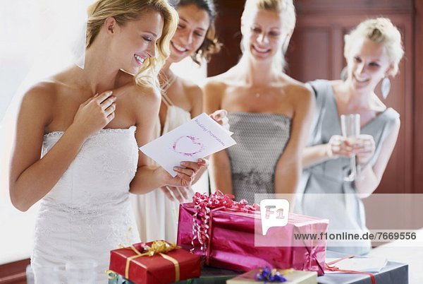 Bride and bridesmaids unpacking gifts