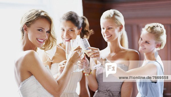 Bride and bridesmaids toasting