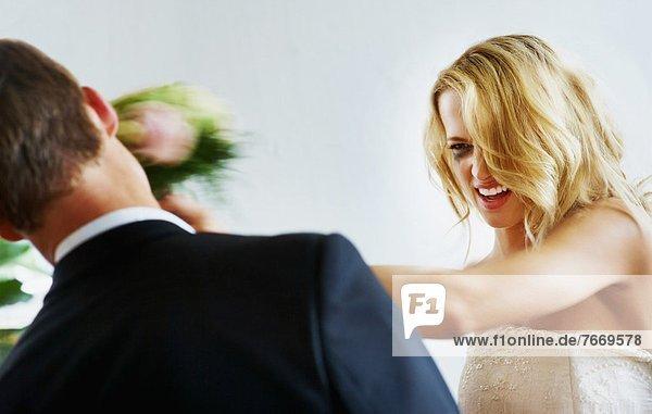 Bride slapping groom