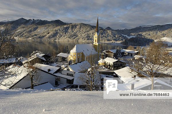 Lake Schliersee with the Church of St. Sixtus in winter  Upper Bavaria  Bavaria  Germany  Europe