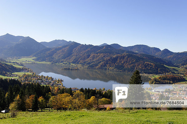 Lake Schliersee and the Parish Church of St. Sixtus as seen from Schliersberg mountain in autumn  Upper Bavaria  Bavaria  Germany  Europe