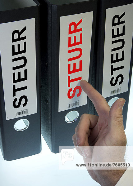 'Hand pointing to file folders labeled ''Steuer''  German for ''tax'''