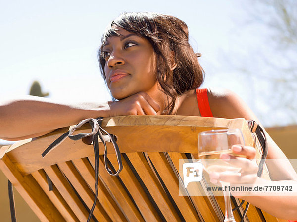 Smiling woman having wine outdoors