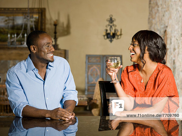 Couple relaxing together at table