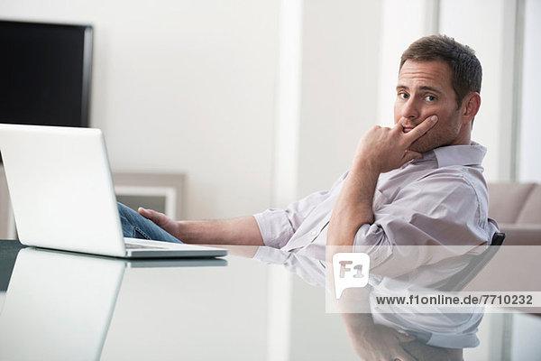 Businessman using laptop at desk
