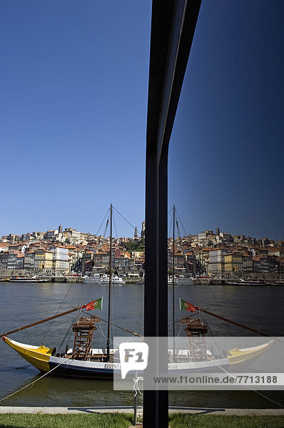 A View Of The City Of Oporto Partly Reflected On A Glass Window