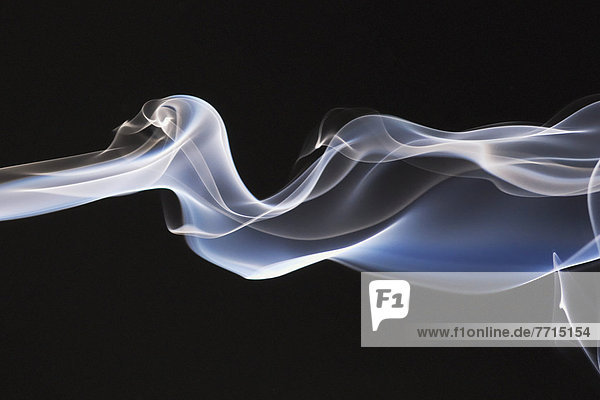 Close-Up Detail Of Smoke Against Black Background