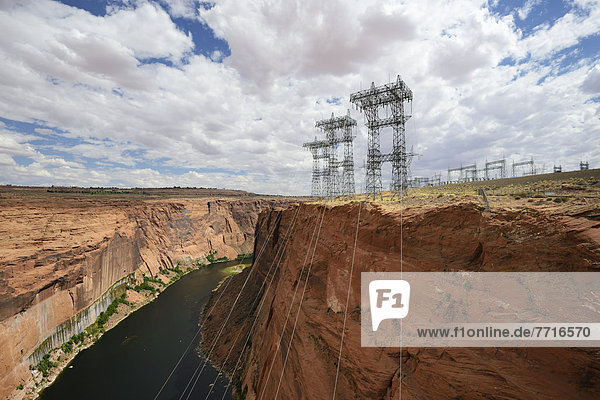 Electricity wires and pylons extending from the glen canyon dam on the colorado river Arizona usa