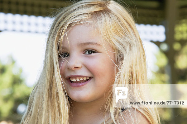 Portrait of a young blonde girl laughing Ontario canada