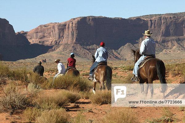 Utah/Arizona. Riding Among The Red Rock Of Monument Valley. Doug Mckinlay/Axiom