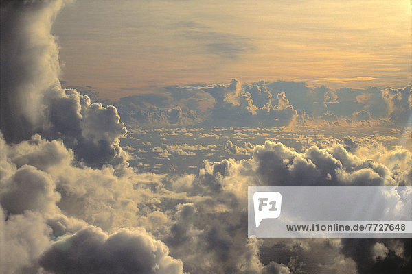 Cumulus Clouds View From Airplane  Soft Lighting At Sunset