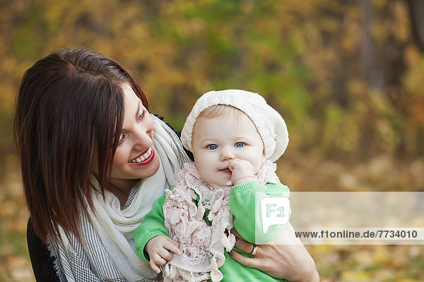 Mother And Baby Girl In The Park In Autumn  Edmonton  Alberta  Canada