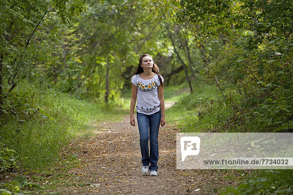 Young Woman Walking On A Path In A Park  Edmonton  Alberta  Canada