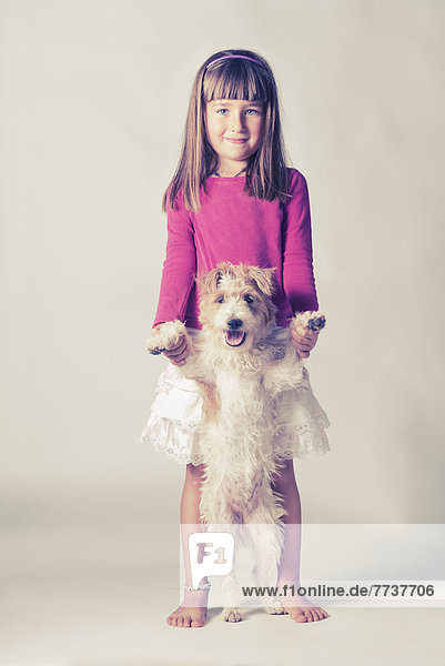 Portrait of a young girl with her dog standing on it's hind legs Malaga andalusia spain
