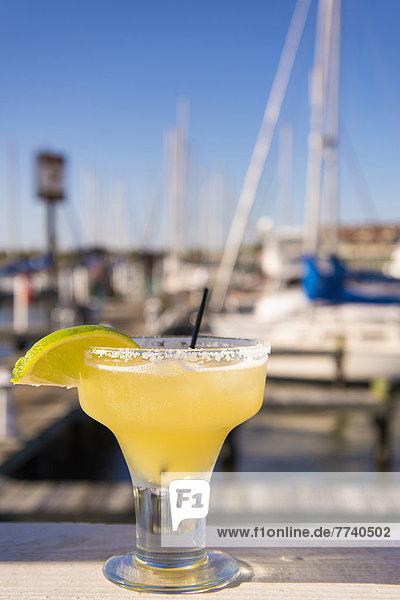 USA  Texas  Rockport  Glass of margarita cocktail in marina bar