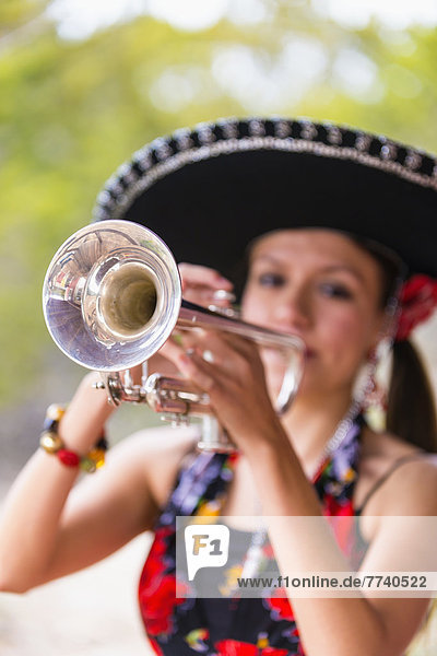 USA  Texas  Young woman playing trumpet