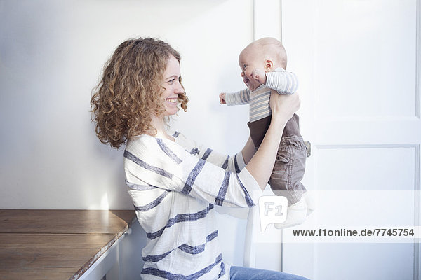 Germany  Bavaria  Munich  Mother holding son  smiling