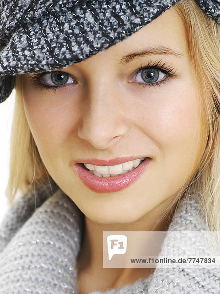 Young woman wearing a gray hat  portrait