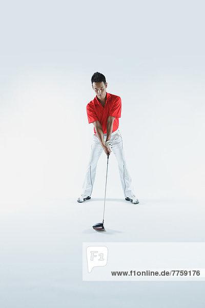 Golfer Preparing For Shot