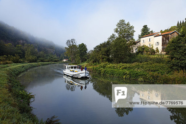 Houseboat on the Canal des Vosges  formerly Canal de l'Est  southwest of the village at about 127 PK  in the morning