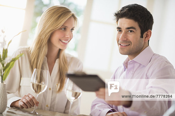 Couple in restaurant  man paying