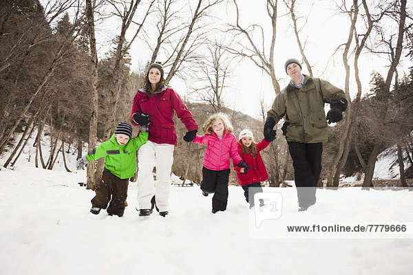 Three children (2-3  4-5) with parents during stroll