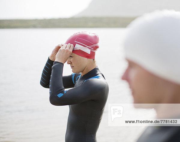 Triathleten mit Brille am Strand
