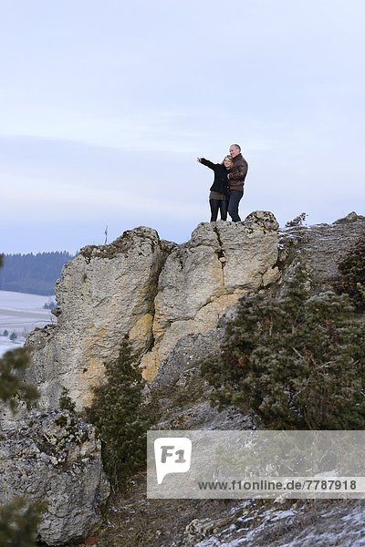 Young couple on a rock  Upper Palatinate  Bavaria  Germany  Europe