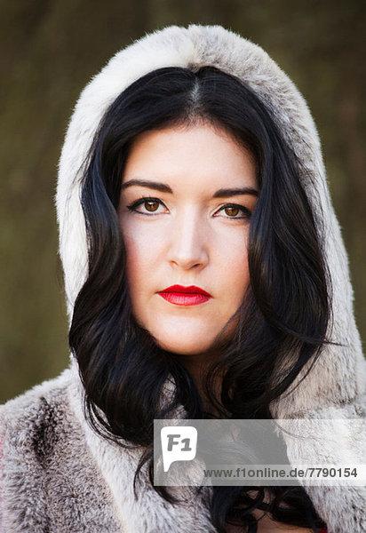 Young woman wearing fur hood