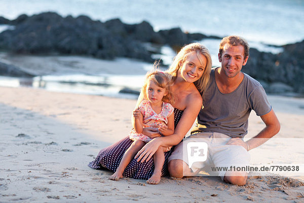 Young family with daughter on beach