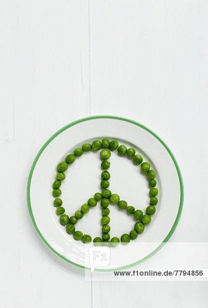 Peace-Zeichen aus Erbsen Peace-Zeichen aus Erbsen