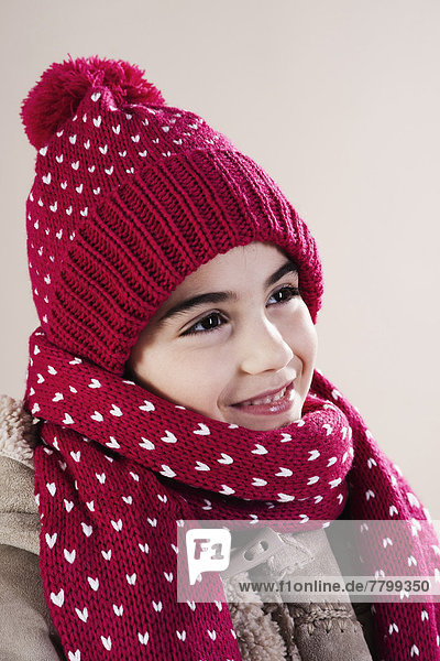 Portrait of Girl wearing Hat and Scarf in Studio