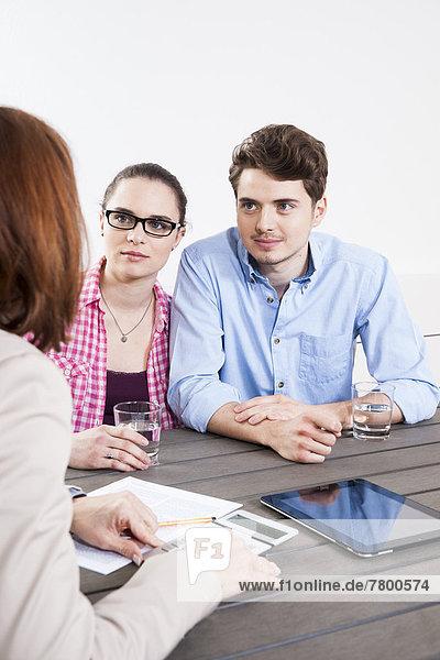 Group of Business People having Meeting in Boardroom