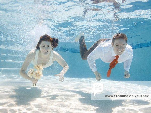 USA  Utah  Orem  Wedding couple under water
