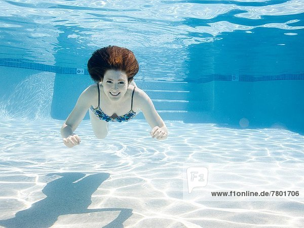 USA  Utah  Orem  Smiling woman swimming in swimming pool