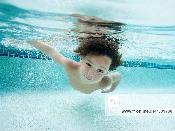 USA  Utah  Orem  Boy (4-5) swimming in swimming pool