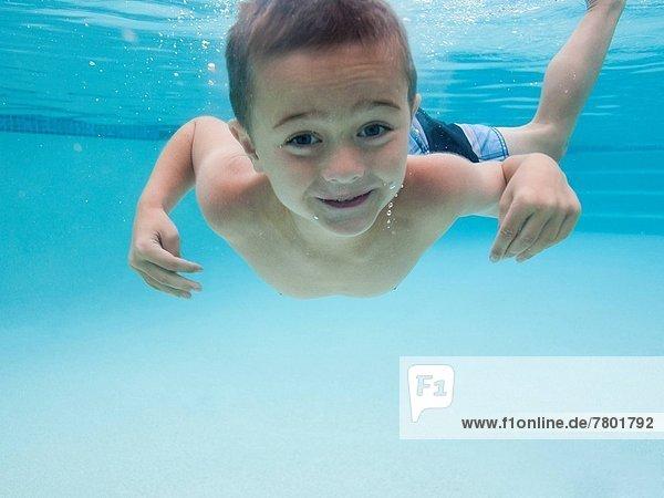 USA  Utah  Orem  Boy (6-7) swimming in pool