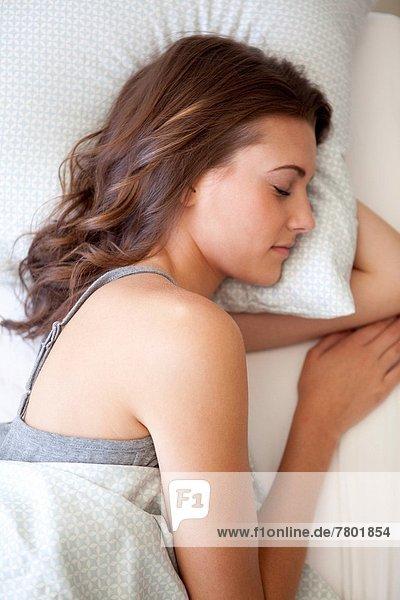 Attraktivität  Frau  Bett  schlafen  jung