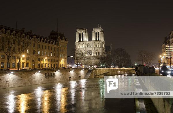 France  Paris  View of Notre Dame de Paris and River Seine by night