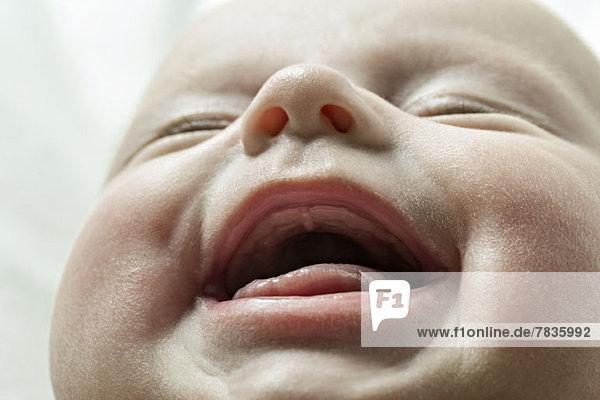 Nahaufnahme des lächelnden Babys Nahaufnahme des lächelnden Babys