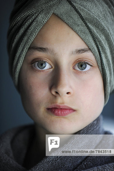 Young girl  10  after a bath wearing a towel turban