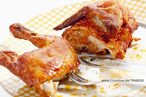 Plate of half roasted chicken  close up
