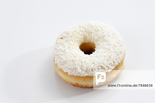 Doughnut topped with icing on white background  close up