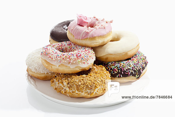 Variety of doughnuts on plate  close up