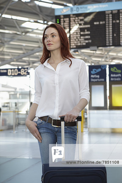 Young woman with luggage at airport