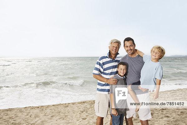 Spain  Portrait of family on beach at Palma de Mallorca  smiling