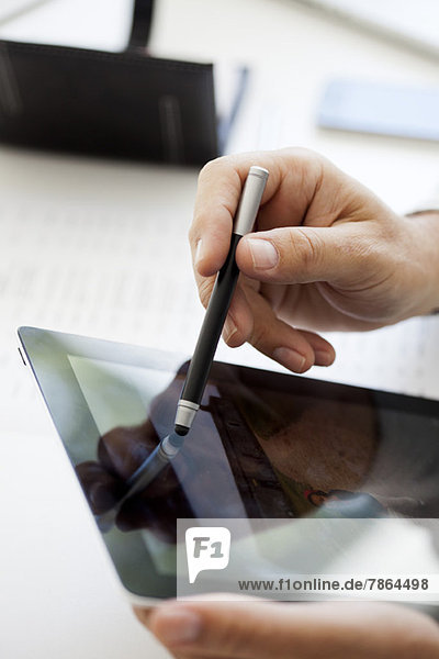 Man using digital tablet and stylus  cropped
