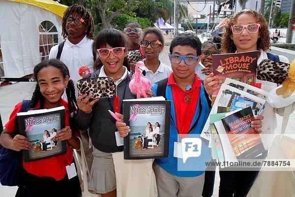 Florida  Miami  Book Fair Miami International  annual event  student  Black  Hispanic  boy  girl  purchases  shopping  books .