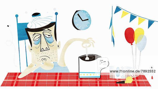 Verkaterter Mann mit Eisbeutel auf der Stirn rührt seinen Kaffee um