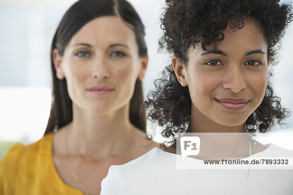 Portrait of two female friends smiling together